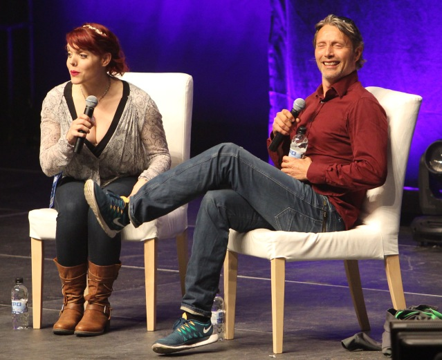 Mads Mikkelsen answers questions as Emily Expo facilitates the event.